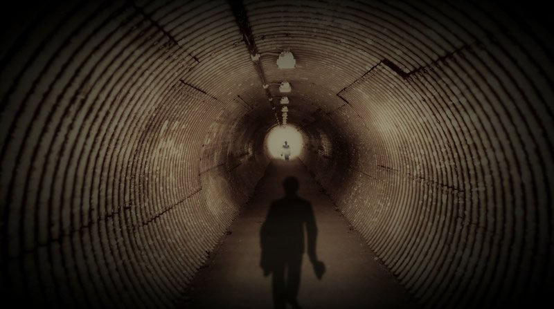 This shows the shadow of a man in a tunnel