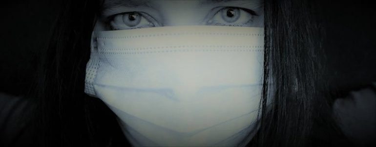 This shows a woman in a facemask