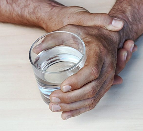 This shows a person holding a cup of wateri