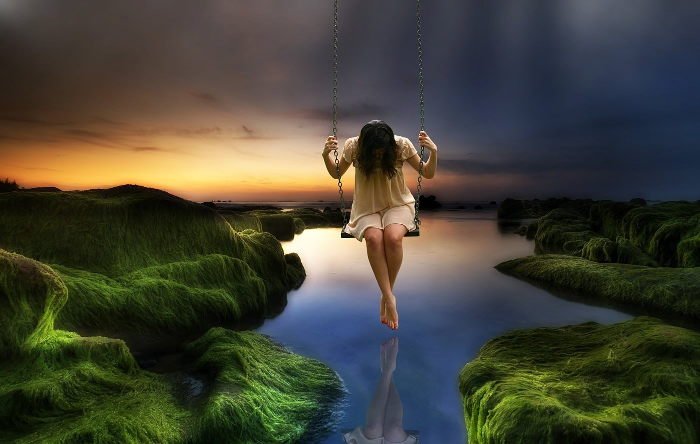 This shows a woman on a swing