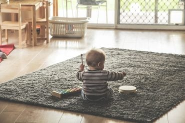 This shows a baby banging a drum