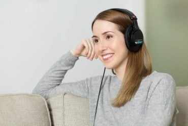 This shows a woman with headphones on