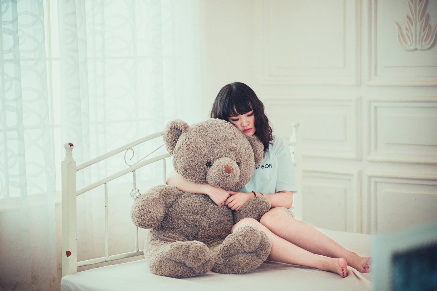 This shows a teenage girl and a teddybear