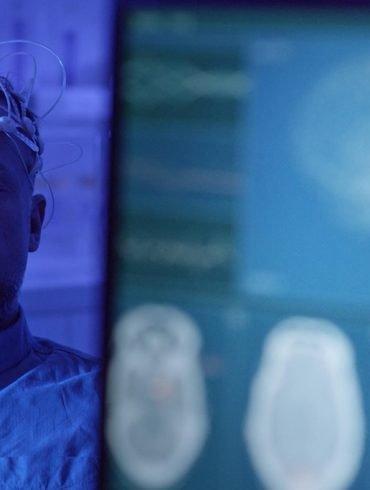 This shows a man in an EEG cap