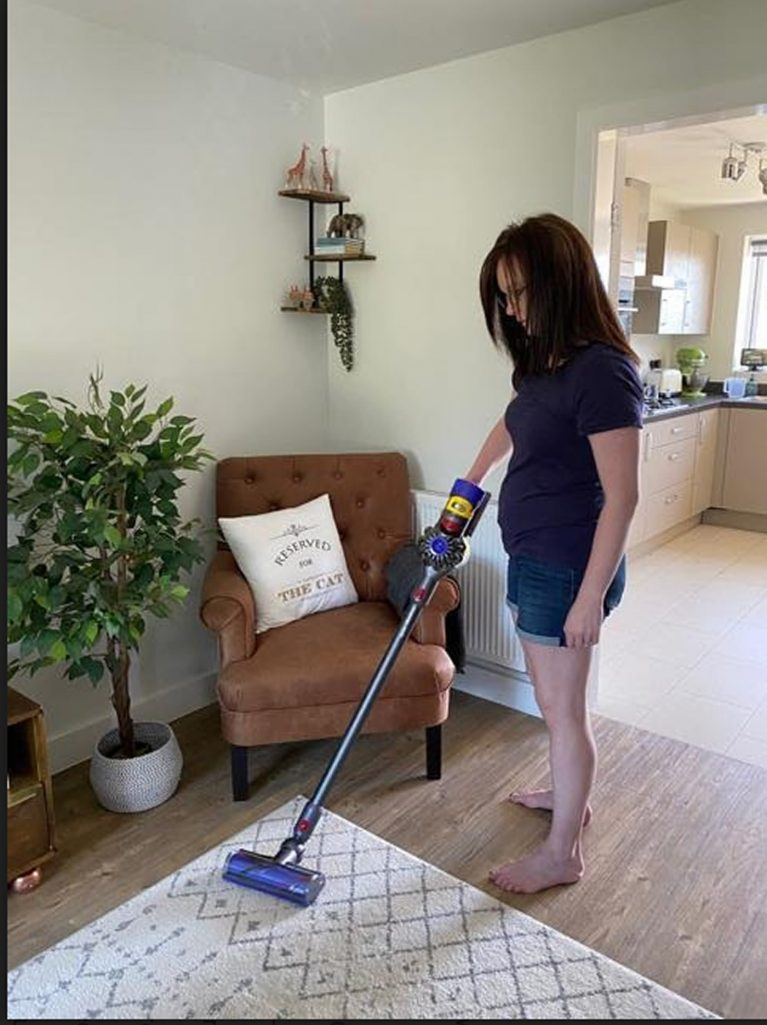 This shows Dr. Bedwell using her dyson