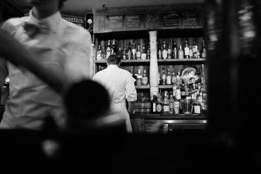 This shows a man at a bar