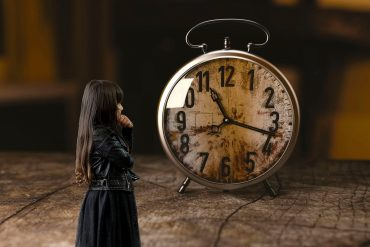 This shows a child and a clock
