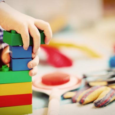 This shows a child playing with building blocks