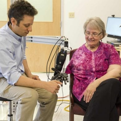 This shows the researcher with a patient