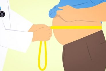 This is a cartoon of a doctor measuring a belly