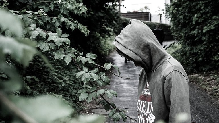 This shows an upset looking teen wearing a hoodie