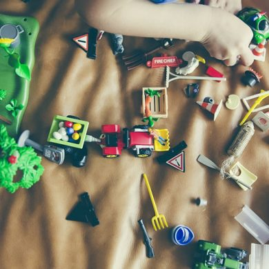 This shows a child playing with toys