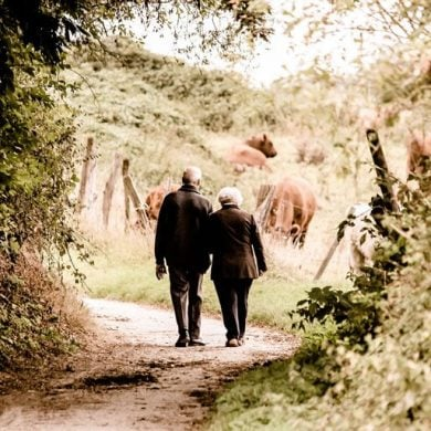 This shows an old couple walking down a lane
