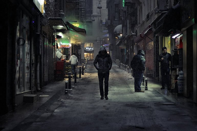 This shows a man walking alone