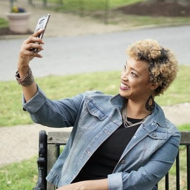 This shows a lady taking a selfie