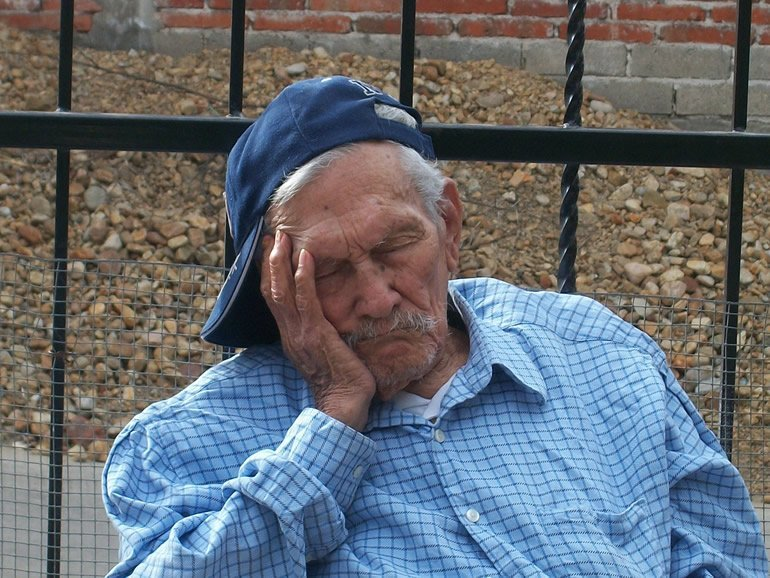 This shows an old man sleeping