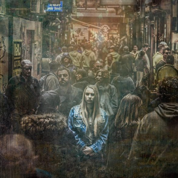 This shows a woman standing out in a crowd