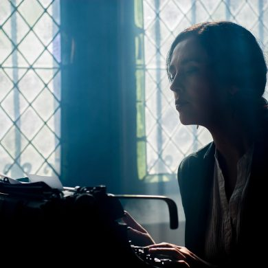 This shows a woman writing