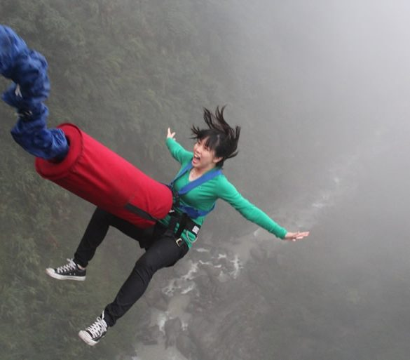 This shows a woman bungee jumping