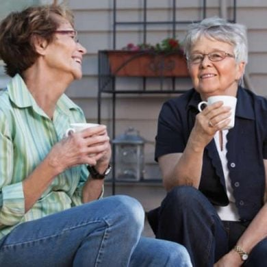 This shows two older ladies having a cup of tea