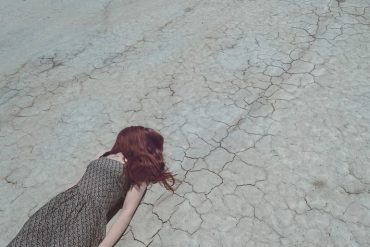 This shows a woman fainting