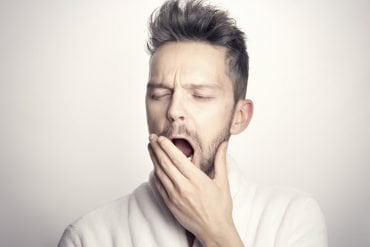 This shows a man yawning