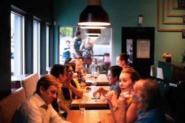 This shows people eating at a restaurant