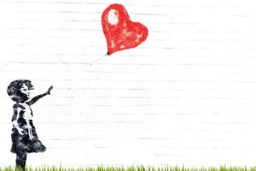 This shows a drawing of a child and a heart shaped balloon blowing away