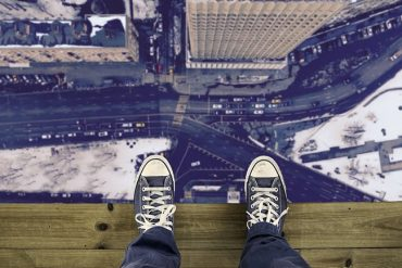 This shows a pair of shoes on a high building