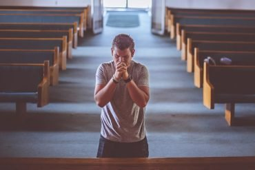 This shows a man praying