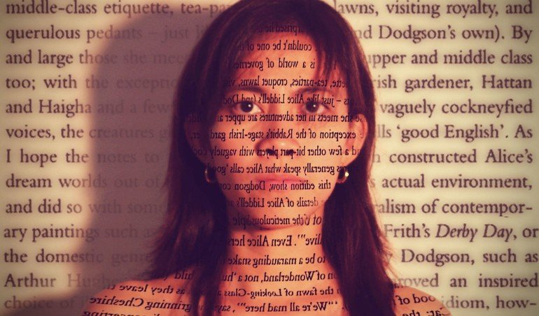 This shows a woman with her face covered in text
