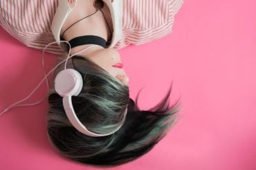 This shows a girl in headphones