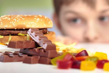 This shows a child looking at junk food