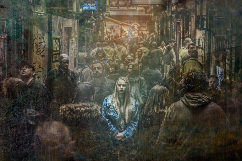 This shows a scared looking woman in a crowd