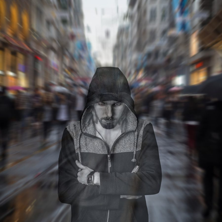 This shows a sad man on a busy street