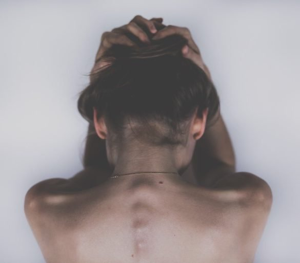 This shows a woman's back