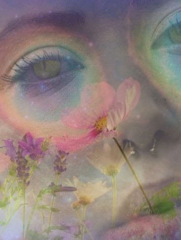 This shows a woman's face and swirly flowers