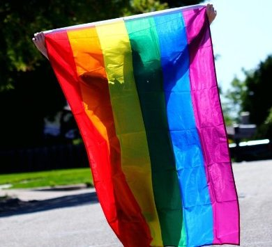 This shows a person with a rainbow flag