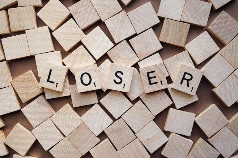 "This shows the word ""Loser"" spelled out in scrabble tiles"