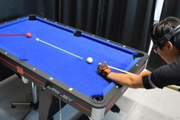 This shows a person playing pool