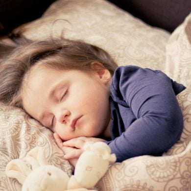 This shows a toddler sleeping