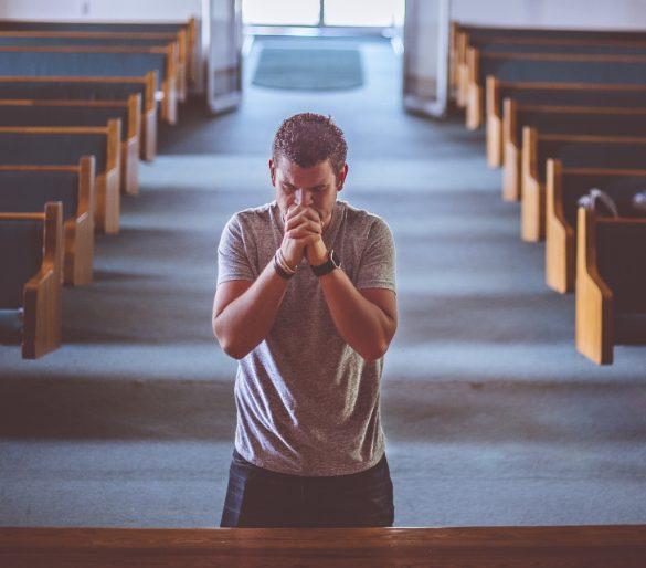 This shows a man praying