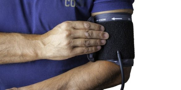 This shows a man taking his blood pressure