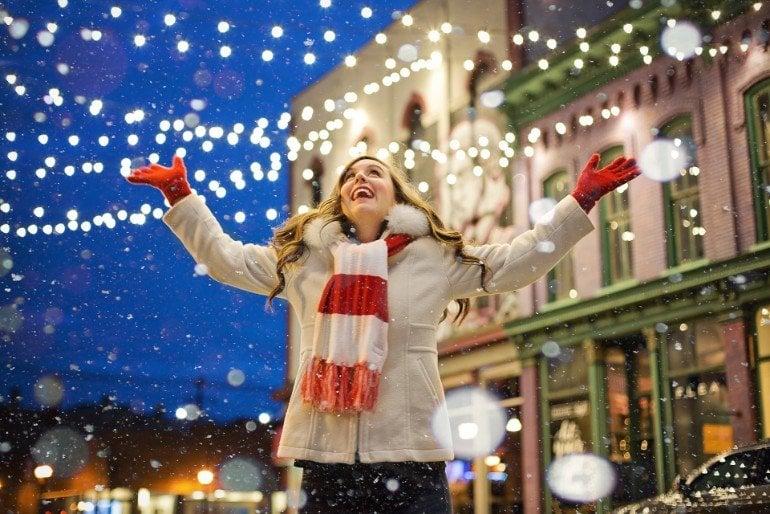This shows a woman and christmas lights