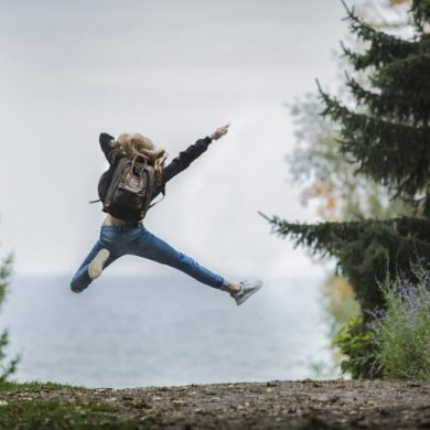 This shows a woman jumping for joy
