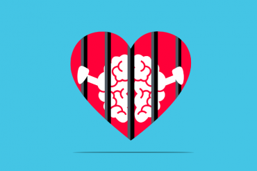 This shows a heart with prison bars and a brain behind it