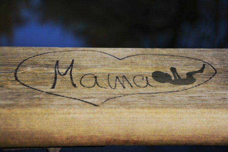 This shows a heart with the word mama and a drawing of a baby