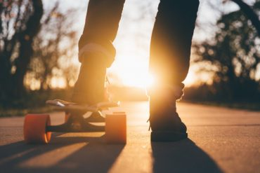 This shows a teen skateboarding