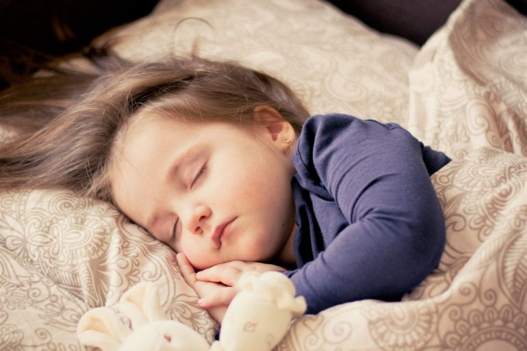 This shows a little girl sleeping