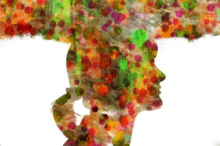 This shows the colorful outline of a woman's head with a colorful cloud-like thought bubble above it